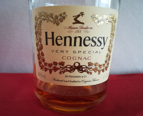 A close-up of a Hennessy bottle